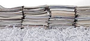 Stacks of books and paper shreds