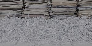 stacks of books with paper shreds