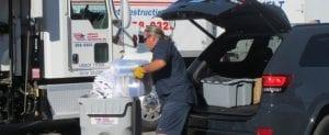 American Document Destruction worker emptying paper into bin