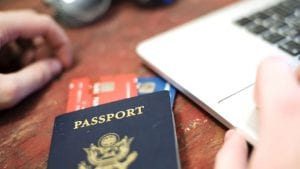 Passport and credit cars next to laptop
