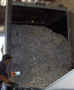 American Document Destruction truck filled with paper shreds