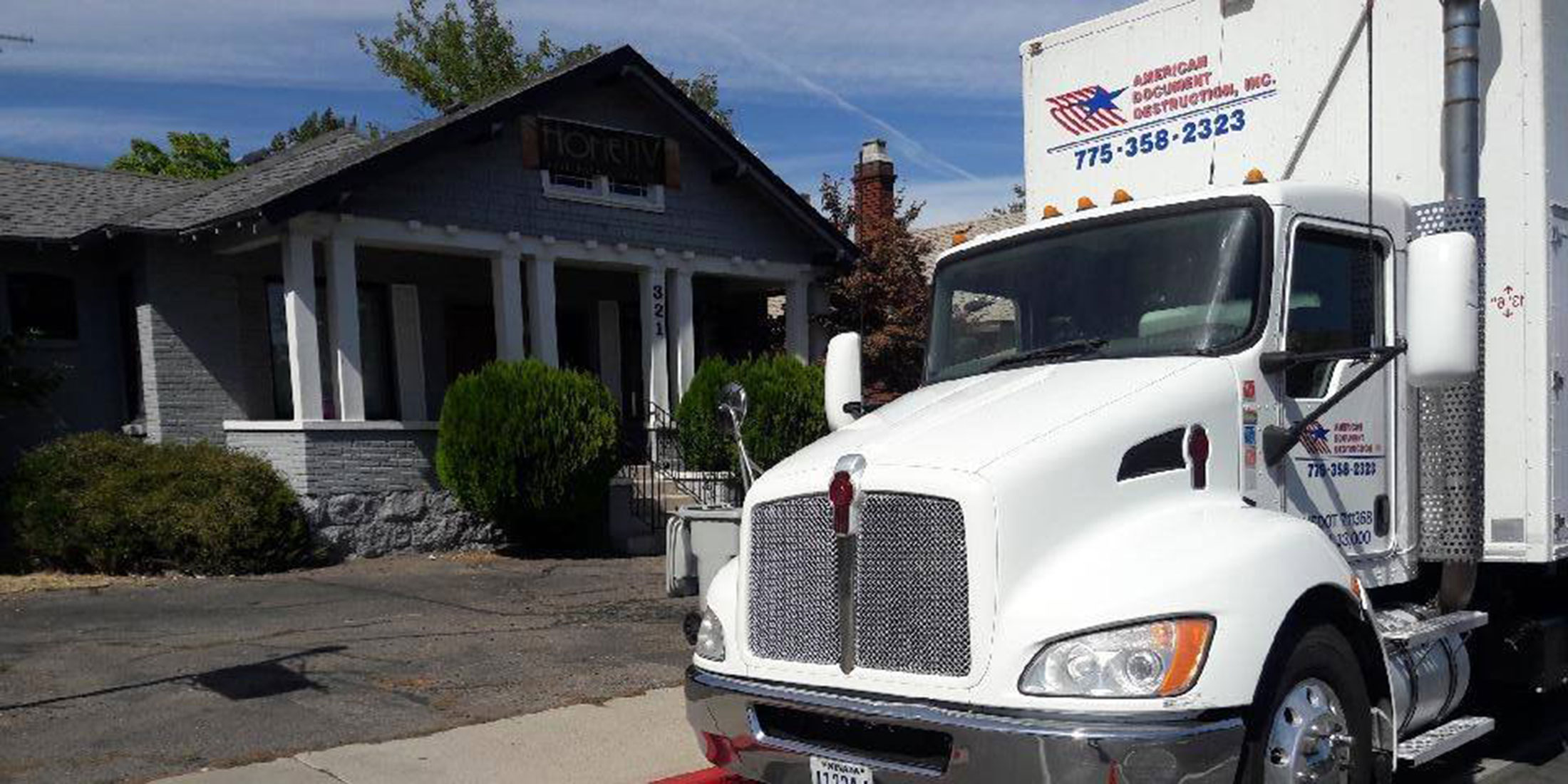 American Document Destruction truck in front of residential home