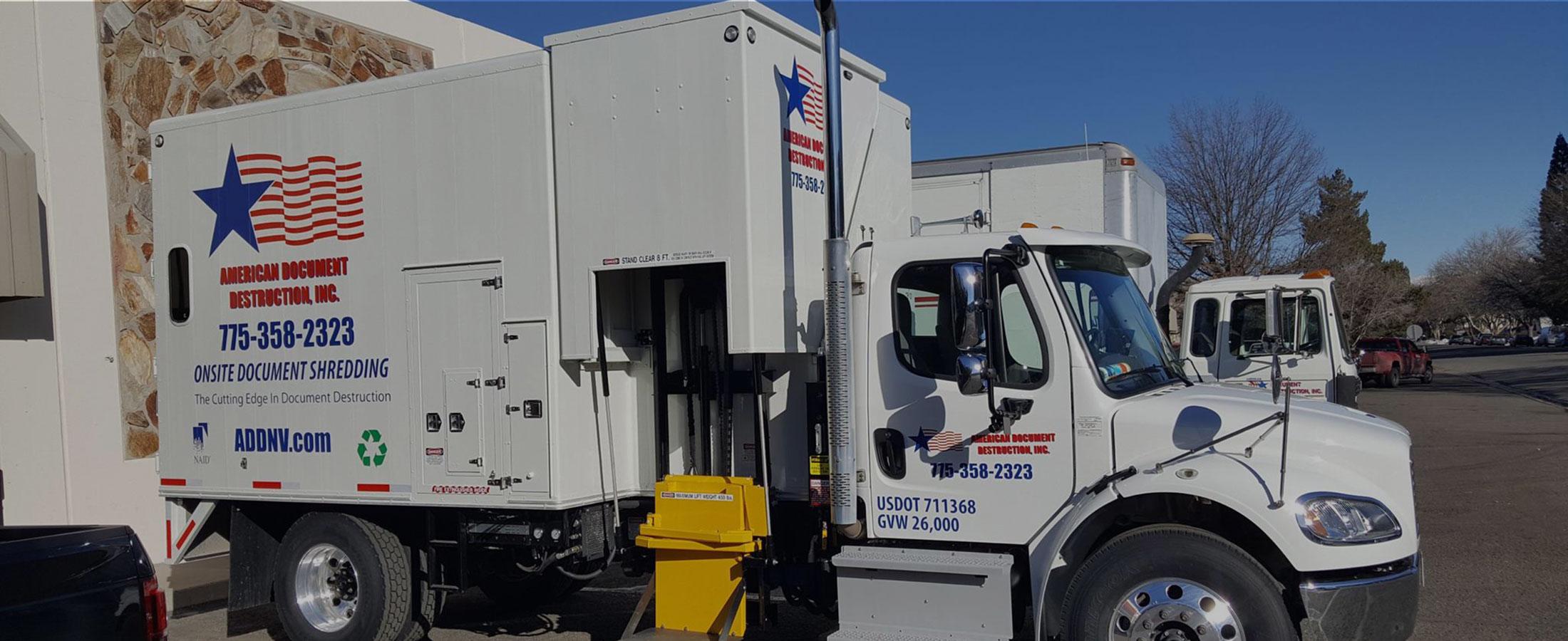 Multiple American Document Destruction trucks parked