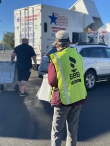 Man wearing a BBB Shred Day green vest