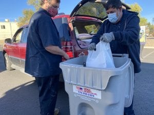 Two American Document Destruction workers assisting with BBB Shred Day