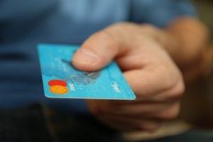 Blue mastercard being held